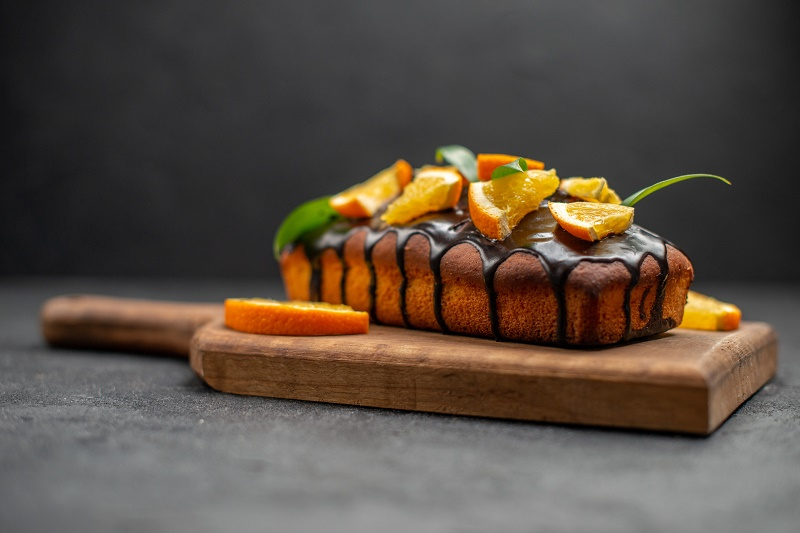 delicious-cakes-decorated-with-orange-chocolate-wooden-cutting-board-black-table.jpg (96.74 Kb)
